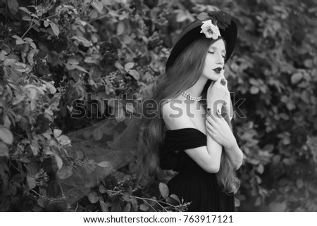 Black and white art monochrome photography woman with very long hair with unusual appearance in
