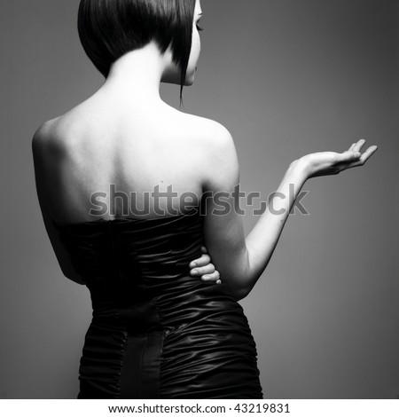 Black and white art photo. Elegant lady with stylish short hairstyle. - stock photo