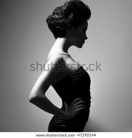 Black and white art photo. Elegant lady with stylish short hairstyle. - stock photo