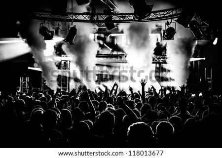 Black and white audience crowd silhouette dancing to dj pete tong at cream nightclub party