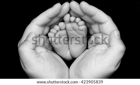 Black and white baby feet with rings