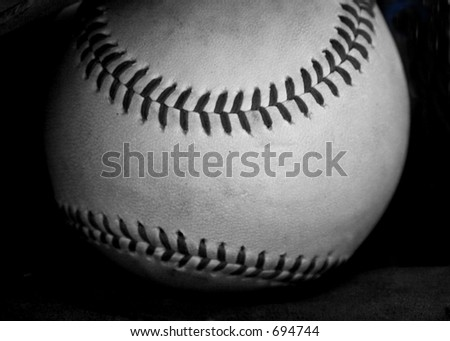 black and white baseball, close-up on a black background - stock photo