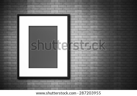 black and white blank photo frame on old brick wall - stock photo