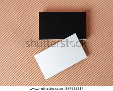 Black and white business cards on color background. Mock-up for branding identity. Isolated with clipping path. Top view.