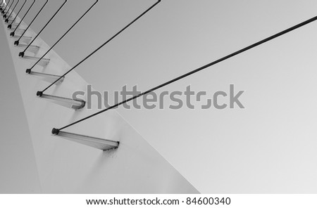Black and white Cable support portion of pedestrian bridge - stock photo