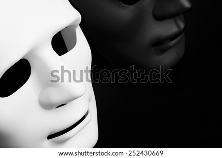 Black and white carnival mask on black background - stock photo