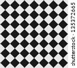 Black and white checkered floor tiles with texture. This tiles seamlessly as a pattern. - stock photo