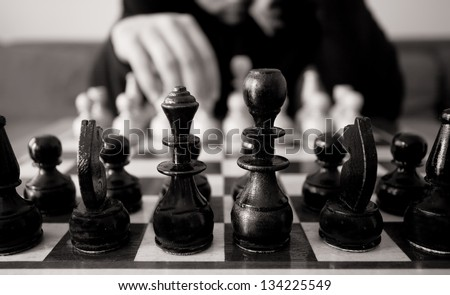 black and white chess concept with man make move - stock photo