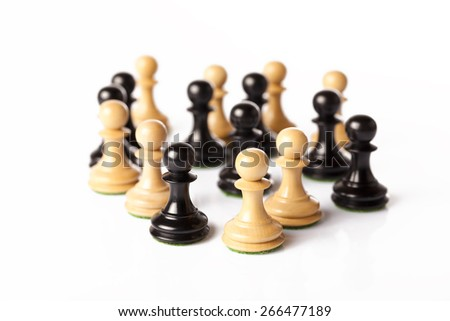 black and white chess pawns on a table - stock photo