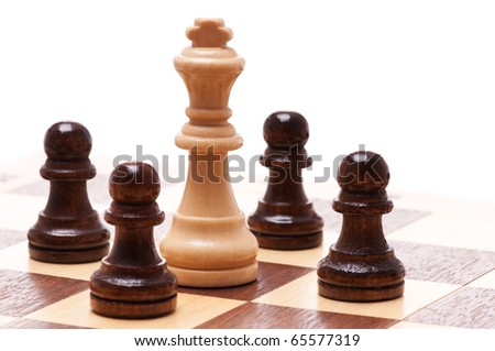 Black and white chess pieces isolated on a white background