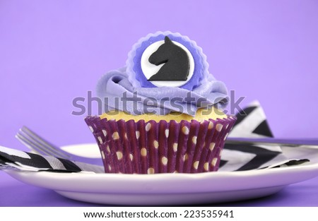 Black and white chevron with purple theme party luncheon table place setting for Melbourne Cup, Australian public holiday, horse race event cupcake. - stock photo