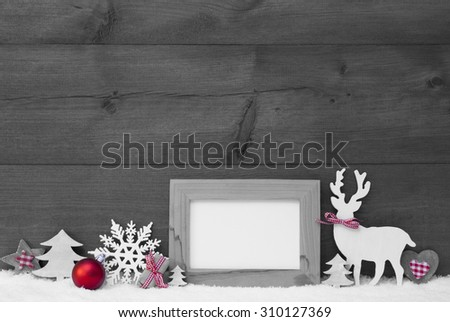 Black And White Christmas Decoration.Empty Blank Picture Frame Reindeer Christmas Trees Snowflake Red Ball On Snow. Christmas Card For Seasons Greetings.Copy Space For Advertisement. Wooden Background - stock photo