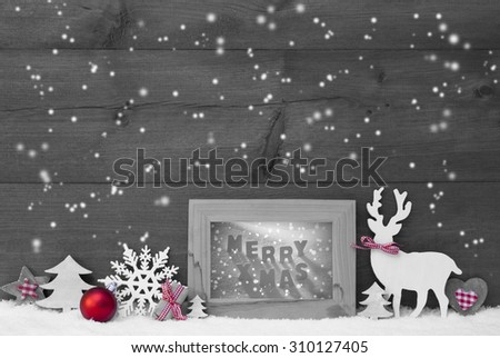 Black And White Christmas Decoration With Reindeer Christmas Trees Snowflakes Red Ball On Snow. Picture Frame With English Text Merry Xmas. Christmas Card For Seasons Greetings. Wooden Background - stock photo