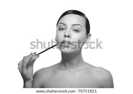 black and white Close up a young beautiful brunette girl with brush near her lips isolated - stock photo