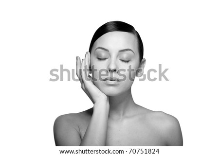 black and white Close up a young beautiful brunette girl with hand near her closed eyes isolated - stock photo