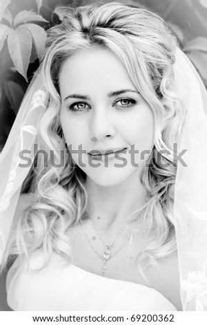 black and white close-up portrait of beautiful blonde bride - stock photo