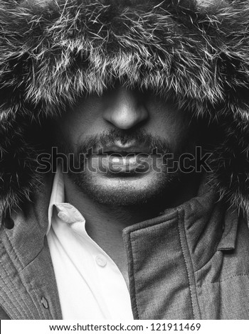 Black And white close up portrait of mysterious man - stock photo