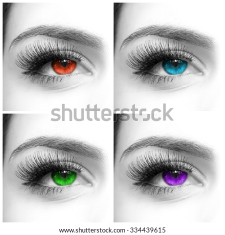 Black and white close-up shot of female eye with different pupil colors - stock photo
