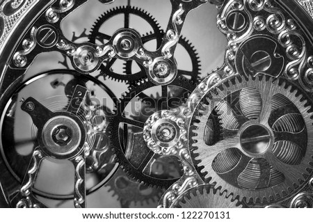 black and white close view of watch mechanism - stock photo