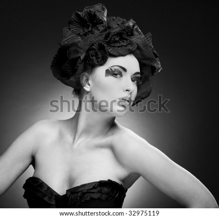 Black and White Closeup portrait of a beautiful young woman. Fashion art photo