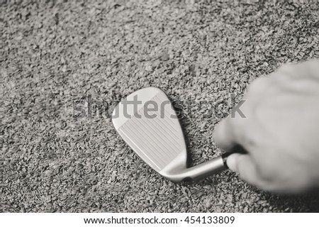 Black and white closeup view of person holding in hand golf club during shoping. - stock photo