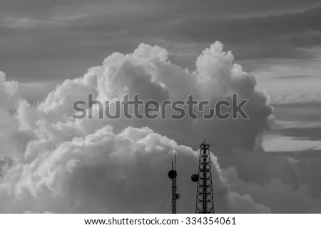black and white clouds and sky with top of antenna