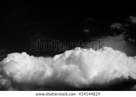 Black and white clouds texture on the dark sky background abstract