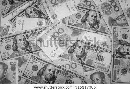 Black and white color of hundred banknote,Chinese currency yuan and American dollars - stock photo