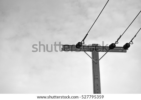 black and white concept electric pole with sky background