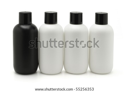 Black and white cosmetic containers on white background - stock photo