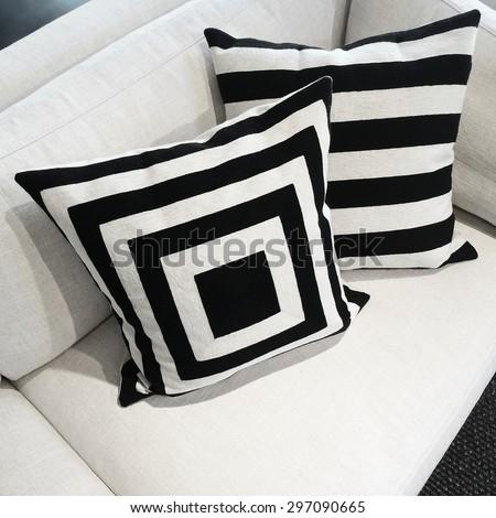 Black and white cushions on a sofa. Modern furniture. - stock photo