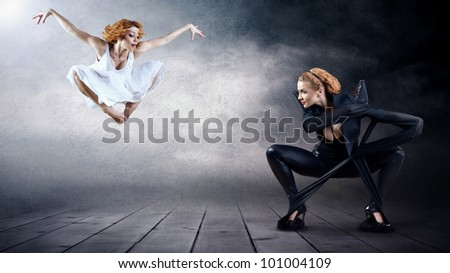 Black and White Dancers in posing on background (on the photo one person - one model release) - stock photo