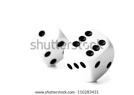 Black and white dice against a white background - stock photo