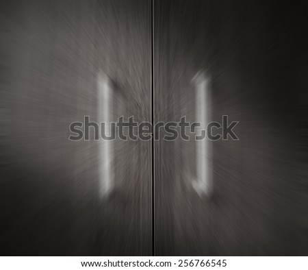 Black and White Door handle with the Smooth light from the left. - stock photo