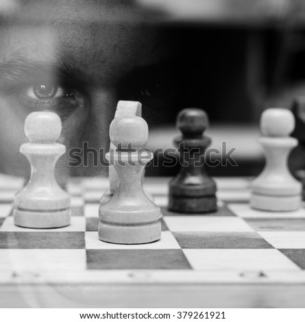 Black and white double exposure of the man and chess - stock photo