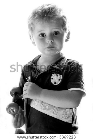 Black and white emotional little boy - stock photo
