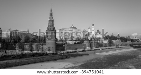 Black and white envelope size view of red walls of sunset Kremlin in Moscow near iced river in winter - stock photo