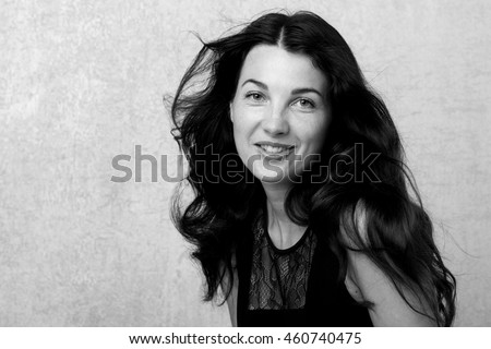 Black and White Fashion Model Girl Portrait with Long Blowing Hair.