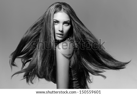 Black and White Fashion Model Girl Portrait with Long Blowing Hair. Glamour Beautiful Woman with Healthy and Beauty Hair - stock photo