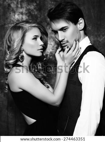 black and white fashion studio photo of beautiful sensual couple in elegant clothes  - stock photo