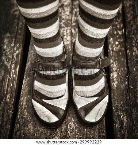 black and white Female legs in striped socks in vintage style - stock photo