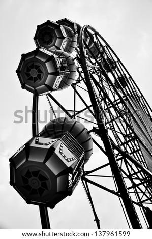 Black and white ferris wheel, vertical - stock photo