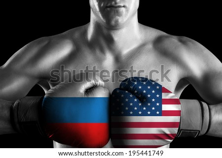 Black and white fighter with Russia and USA color gloves - stock photo