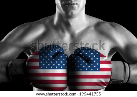 Black and white fighter with USA color gloves - stock photo