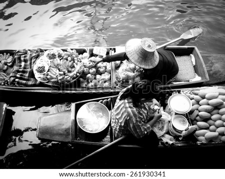 Black and white floating market in Thailand with vignette filter effect