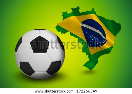 Black and white football against green brazil outline with flag