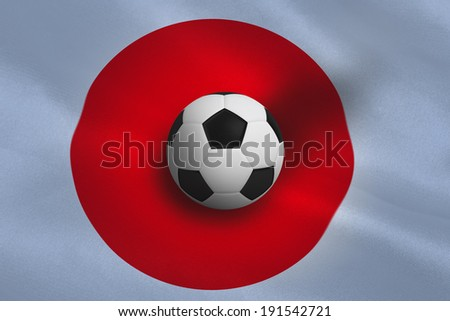 Black and white football against japan flag