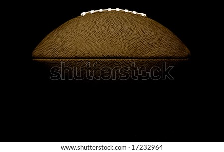 Black and White football from shadow with room for copy - stock photo