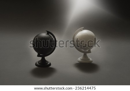 black and white globes divided apart - stock photo
