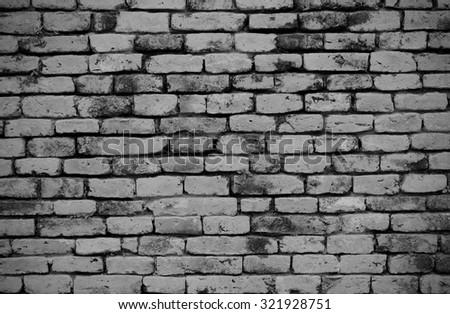 black and white grunge brick wall background - stock photo